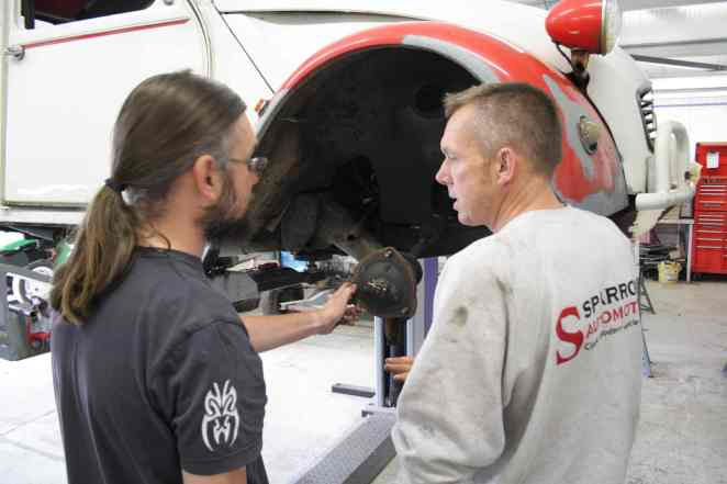 Pete Sparrow instructs Ian on track rod end removal