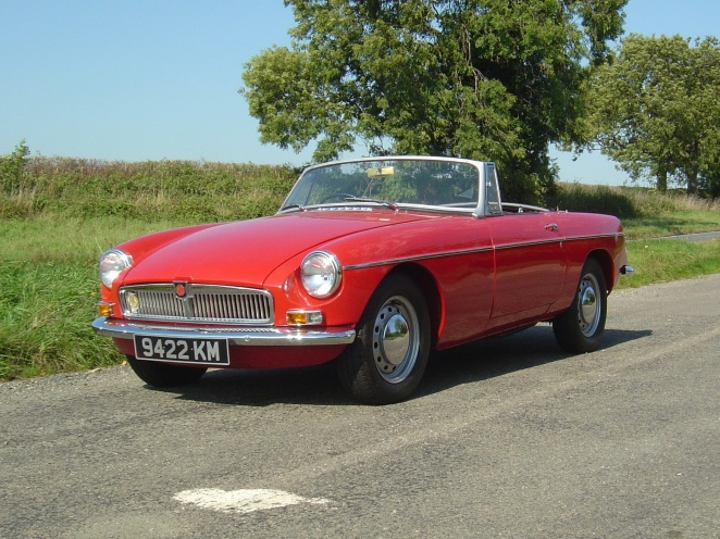 Yes, a red MGB. Big wows. Oh, hold on. It's an early one!