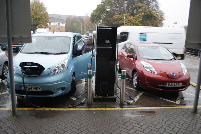 A LEAF awaits its charge as the e-NV200 fills up
