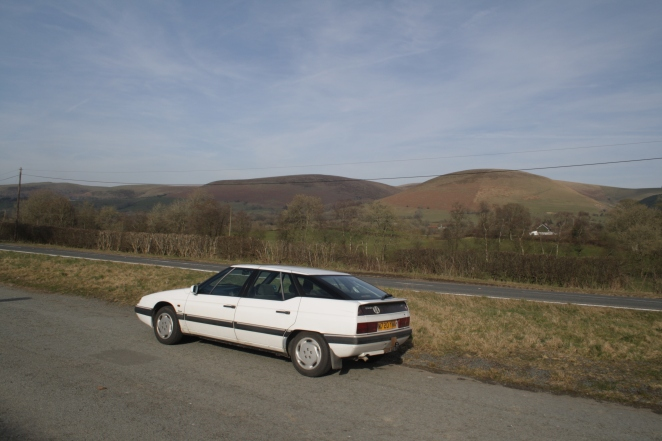 XM pauses in Welsh border country. Stunning. View and car.