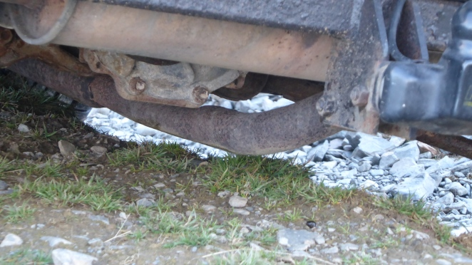 Oh dear. Exhaust is rather vulnerable. This isn't a deep rut.