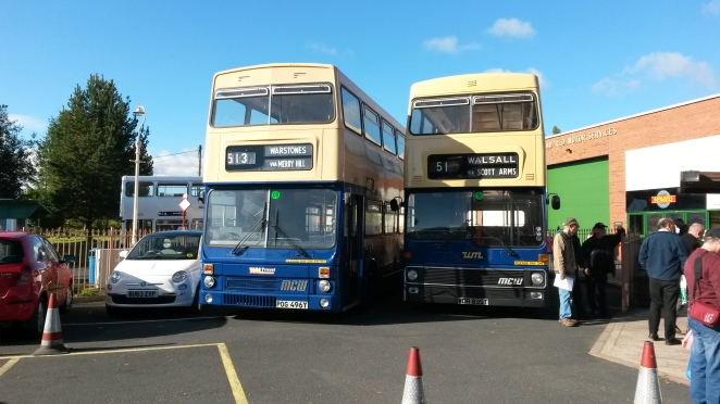 A pair of West Midlands Travel Metrobuses.